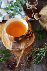Healthy herbal tea with medicinal herbs, dog rose and honey