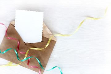 festive positive message/ Open letter with clean patterned blank and colored ribbons of serpentine