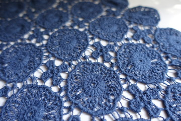 Dainty blue cotton lace on white background
