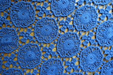 Delicate blue lacy fabric on wood from above