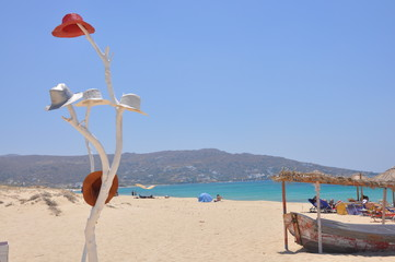 White decorative tree with hats in Naxos beach picture, Greece