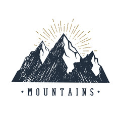 """Hand drawn inspirational label with mountains textured vector illustration and """"Mountains"""" lettering."""