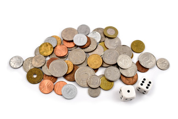 Coin stock images.  Different coins on a white background. Different types of currencies. Money and dice