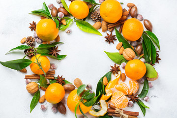 Christmas wreath with spices and tangerine