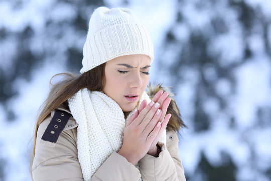Woman suffering a cold winter outdoors