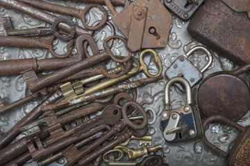 Close up view of old  padlock and keys on a metal  background