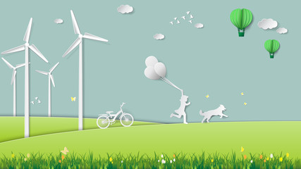 Paper folding art origami style vector illustration. Renewable energy ecology technology concepts, girl is running and holding balloons with her dog in green meadow park which full of wind turbine.
