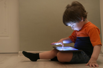 Young kid playing on a floor in a room