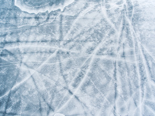 Aerial top down view over icy lake surface pattern, near Grutas park, Lithuania.