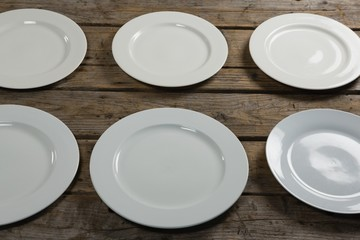 Empty plates arranged in row