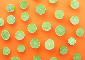 Sliced of  limes on wood background,top view