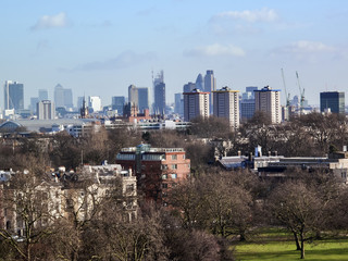 View from Primrose Hill Regents Park of the architecture and financial district of  London England UK