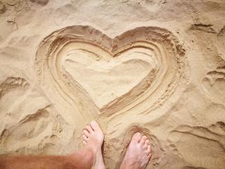 Heart shape drawing on the sand on Teresitas beach in Tenerife