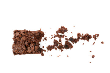 Brownie and crumbs on a white background