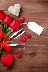 Valentines day roses bouquet and champagne glasses