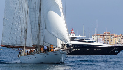Sailing yacht and motorboat on anchorage of  St. Tropez  Bay