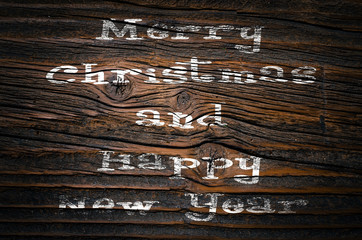 Christmas wishes on an old wooden plank. Close up