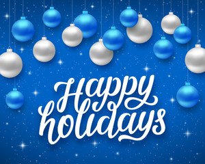 Happy Holidays script text on blue background with sparkles and colorful hanging balls. Vector illustration for holidays with lettering