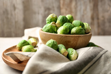 Bowl with fresh raw Brussels sprouts on table