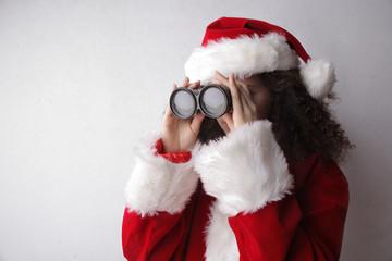 Santa Claus using binoculars