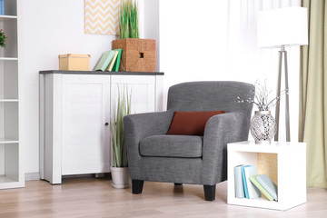 Beautiful interior with armchair and pillow