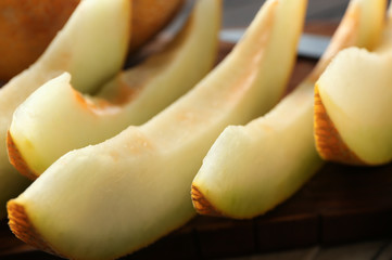 Yummy melon slices on table, closeup