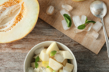 Composition with yummy melon on wooden table