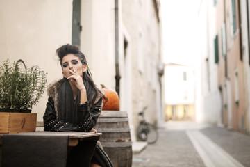 Stylish woman smoking a cigarette