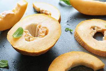 Yummy cut melon on grey background