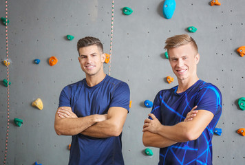 Young men in climbing gym