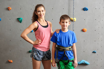 Boy and instructor in climbing gym