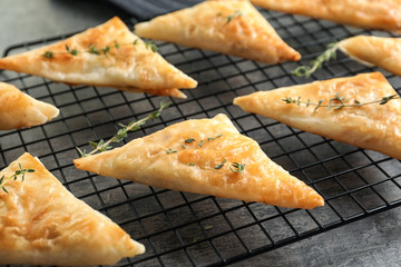 Cooling rack with delicious samosas on table
