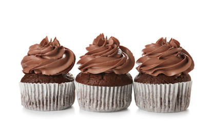 Delicious chocolate cupcakes on white background