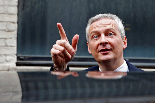 """French Finance Minister Bruno Le Maire points after he visits the new logistic hub of """"Vestiaire Collective"""" an online marketplace to buy and sell pre-owned designer clothing and accessories, in Tourcoing"""