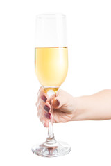 Woman hand holding a glass of expensive golden champagne