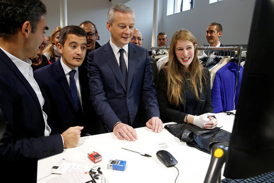 """French Finance Minister Bruno Le Maire and Minister for Public Action and Accounts Gerald Darmanin, visit the new logistic hub of """"Vestiaire Collective"""" an online marketplace in Tourcoing"""