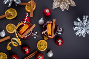 Cinnamon tea with orange peels and sticks red mulled wine hot pu