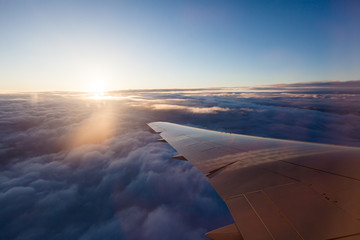 Watching the sunrise from an airplane