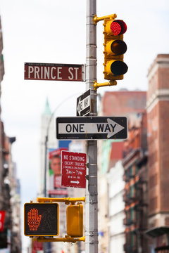A one way sign and a traffic light in Ney York City, NYC