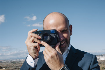 man using photo camera