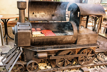 Recess Fitting Vintage cars Barbecue grill with meat in shape of steam locomotive, yellow filter