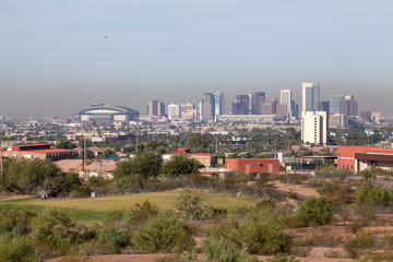 A city rises out of the desert in Arizona