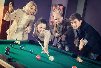 Group of adults playing pool.