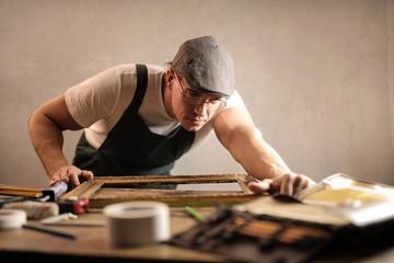 Artisan repairing a frame