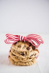 Stack of chocolate chip cookies tied up in a bow.
