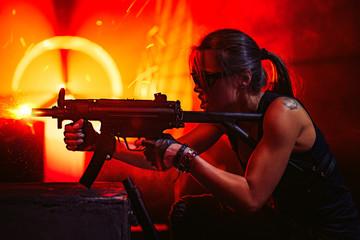 Woman warrior with gun
