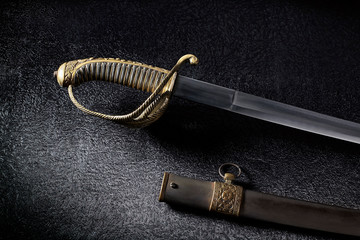 An ancient saber with a beautiful handle.