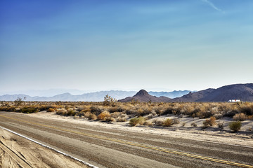 Desert highway at sunset, travel concept picture, USA.