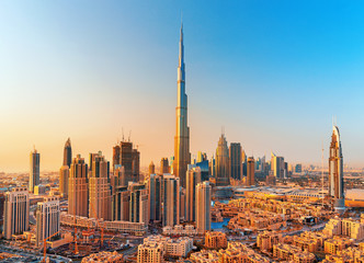 Foto op Plexiglas Dubai DUBAI ,UNITED ARAB EMIRATES-FEBRUARY 18, 2017: Beautiful Dubai downtown at the sunset,Dubai,United Arab Emirates