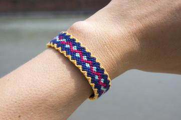 Handmade friendship woven bracelet on the hand